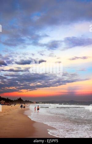 Beach at sunset. Mui Ne, Binh Thuan Province, Vietnam. - Stock Photo