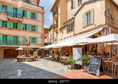 Outdoor restaurant with dining people on small city square in Monaco-Ville, Monaco. - Stock Photo