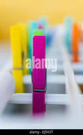 Colored pegs on a washing line - Stock Photo