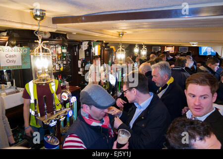 Rugby fan crowd / fans at crowded busy bar - The Barmy Arms pub / public house. Twickenham UK; popular on match - Stock Photo