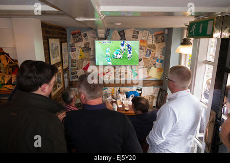 Rugby fans & TV inside The Eel Pie pub / public house / tavern. Church St. Twickenham UK; popular with Rugby fans - Stock Photo