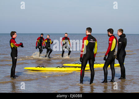 Ainsdale, Merseyside, Southport, UK. 22nd March, 2015. UK Weather:  RNLI volunteer Lifeguards practice rescue land - Stock Photo