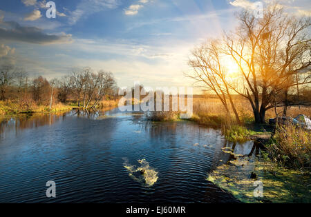 Wonderful autumn on a river at sunrise - Stock Photo