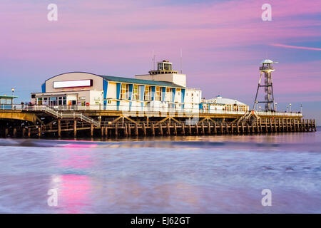 Bournemouth pier at Sunset from the beach Dorset England UK Europe - Stock Photo
