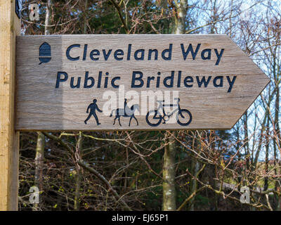 Cleveland Way Public Bridleway long distance footpath signpost with signs for walker horse rider and bicycle - Stock Photo