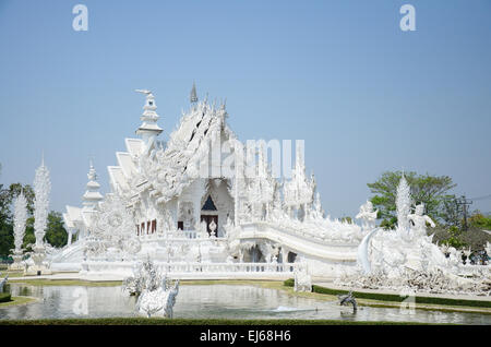 A Famous place for tourist known as name White Temple (วัดร่องขุ่น or Wat Rong Khun) is beautiful handcraft and - Stock Photo