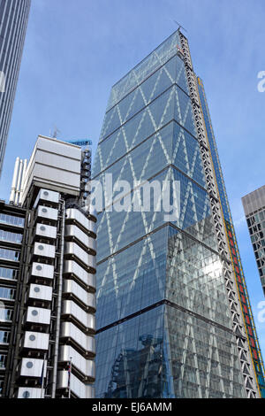 The Cheesegrater skyscraper (also known as 122 Leadenhall Street) rises high above the nearby Lloyds of London building - Stock Photo