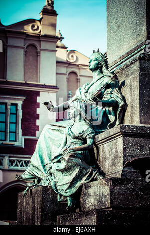 Krakow - fragments of the monument of Adam Mickiewicz. - Stock Photo