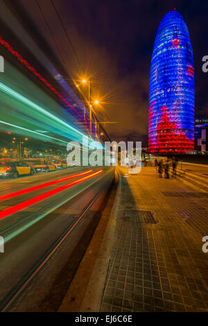 Night view of Torre Agbar skyscraper designed by French architect Jean Nouvel, Barcelona, Catalonia, Spain - Stock Photo