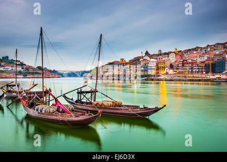 Porto, Portugal old town cityscape on the Douro River with traditional Rabelo boats. - Stock Photo