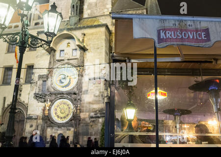 Drinking beer at a terrace by the astronomical clock in Prague, Czech Republic - Stock Photo