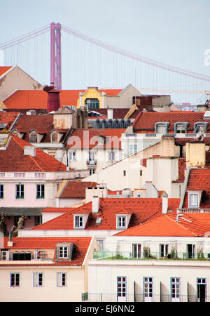 Lisbon rooftops with Ponte 25 de Abril suspension bridge - Stock Photo
