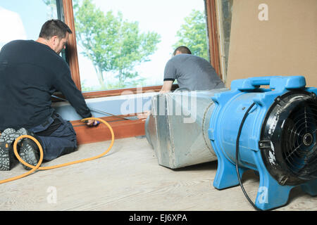 Ventilation cleaner working on a air system. - Stock Photo