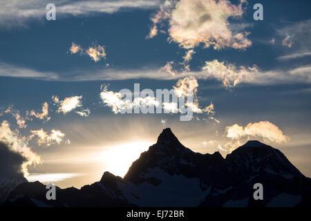 Sunset behind Ober Gabelhorn and Wellenkuppe, from the Berghaus Fluhalp, Zermatt, Canton of Valais, Switzerland - Stock Photo