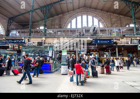 The interior of the always busy Gare du Nord train station in Paris, France. - Stock Photo