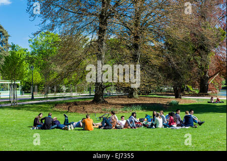 Group of young people relaxing in Parc de l'Orangerie park Strasbourg Alsace France Europe - Stock Photo