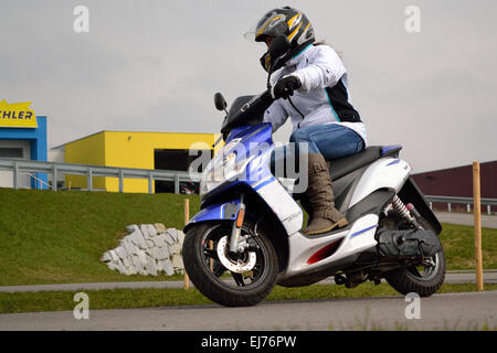 teenager driving autocycle - Stock Photo