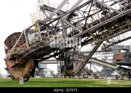 Coal digger is in a disused mining - Stock Photo