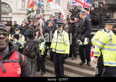 An Anti-racism Demo in London, 21st March 2015. Paul Golding of Britain First pictured on the steps of Eros at Piccadilly - Stock Photo