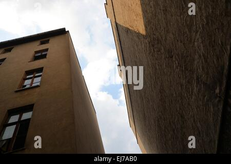 abandoned and empty houses on a backyard - Stock Photo