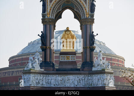 Albert Memorial statue overlooking hazy Royal Albert Hall, in London. The memorial was commissioned by Queen Victoria - Stock Photo