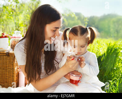 Happy young motherwith her baby - Stock Photo