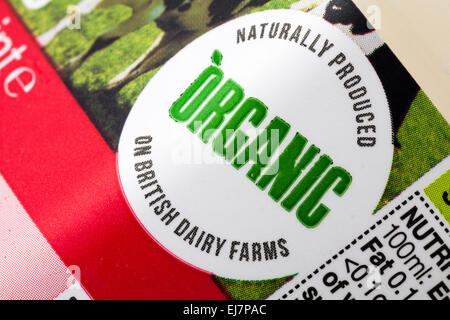 Organic naturally produced on British Dairy Farms - label on 1 pint of Marks & Spencer British Farm Assured skimmed - Stock Photo