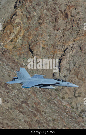 Close Up Of A US Navy F/A-18E Super Hornet Jet Fighter Flying At Low Level Along A Desert Canyon. - Stock Photo