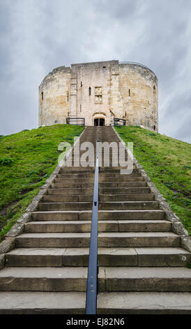 Clifford's Tower, a Norman Motte and Bailey castle in York, England and the only remaining part of Old York Castle - Stock Photo
