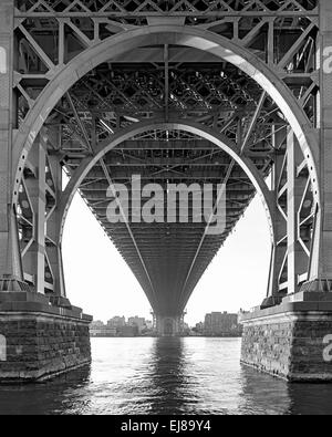 Black and White View from under the Williamsburg Bridge in New York City on a hazy day - Stock Photo