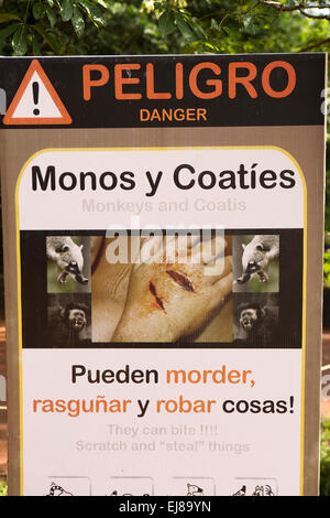 Argentina, Iguazu, Falls National Park, monkeys and coatis danger warning sign - Stock Photo