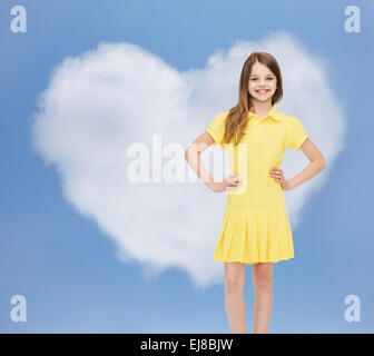 smiling little girl in yellow dress - Stock Photo