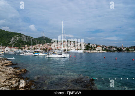 View of Hvar town in Croatia across the harbour - Stock Photo