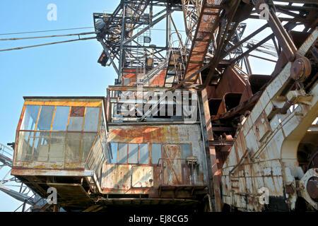 Excavator in open cast mining - Stock Photo