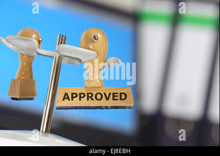 approved marked on rubber stamp - Stock Photo