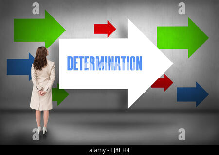 Determination against arrows pointing - Stock Photo