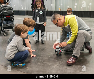 A member of the I LUG NY (Lego Users Group) explains a robot at a Career Expo held at the FIRST Robotics NYC Championship - Stock Photo