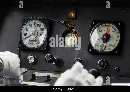 Train Operator on the Hida Express Train in Japan (watch in the center belongs to the operator) - Stock Photo