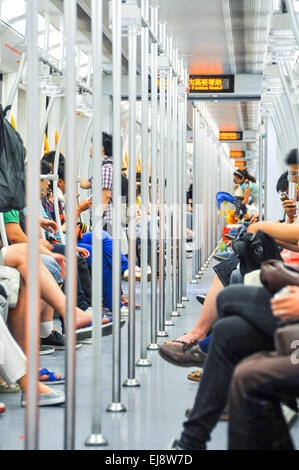 a lot of passengers in the subway car - Stock Photo