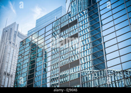 glass wall in modern building skyscrapers - Stock Photo