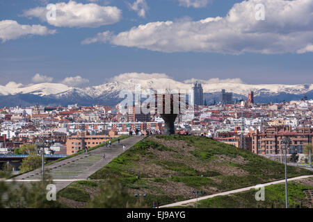 Madrid view from Lineal Manzanares Park with the Dama del Manzanares sculpture, art done by Manolo Valdés. - Stock Photo