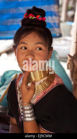 Young woman from the Kayan hill tribe, Myanmar, Burma. wearing the traditional brass neck rings.