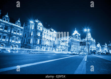 light trails on the bund in shanghai - Stock Photo