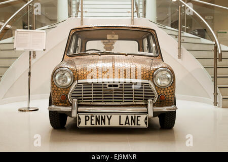 ' Penny Mini ' car, covered with old pennies, possibly linked to the Beatles song ' Penny Lane',  for sale at auction, - Stock Photo