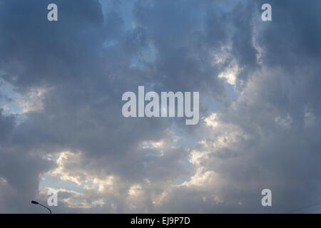Dark gray clouds in dramatic stormy sky - Stock Photo