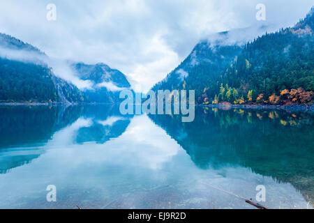 long lake in autumn jiuzhaigou - Stock Photo