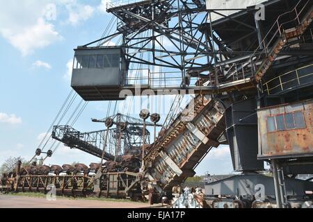 Excavator in the disused lignite opencast - Stock Photo