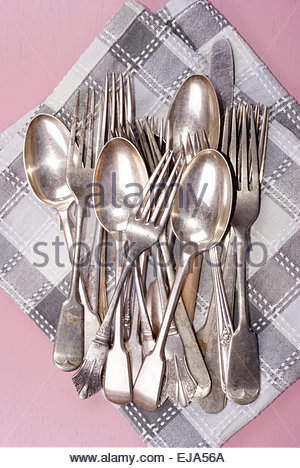 vintage cutlery on a kitchen towel - Stock Photo