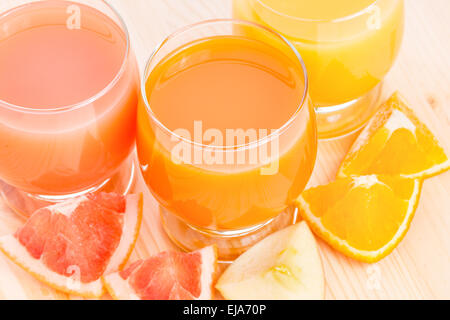 Fresh juice with different pieces of fruits. Top view vitamins healthy eating background - Stock Photo