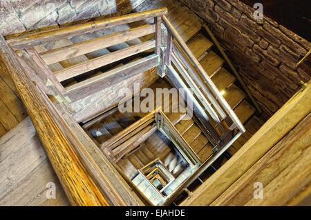 old wooden stairwell - Stock Photo
